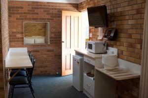 A kitchen or kitchenette at Buckaroo Motor Inn