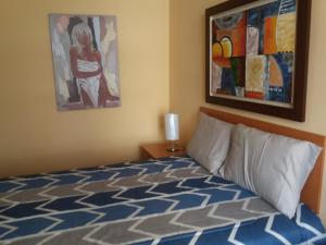 A bed or beds in a room at Miraflores