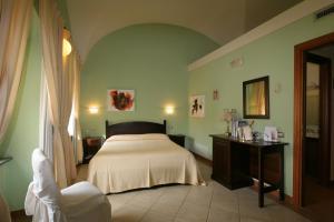 Letto o letti in una camera di Hotel Il Duomo