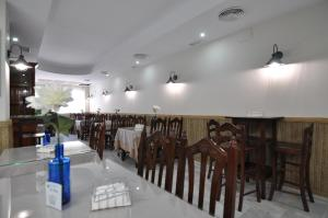 A restaurant or other place to eat at Hostal la Fuente