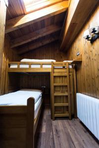 Litera o literas de una habitación en Apartaments Gran Vall