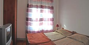 A bed or beds in a room at Tagus Host