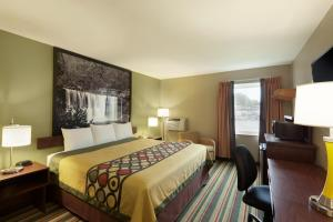 A bed or beds in a room at Super 8 by Wyndham Tuscola