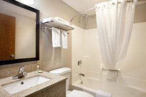 A bathroom at Super 8 by Wyndham Tuscola