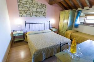 A bed or beds in a room at Tenuta La Lupa