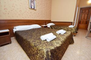 A bed or beds in a room at Гостевой дом Родос 1