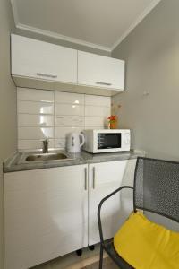 A kitchen or kitchenette at Hostel Garden