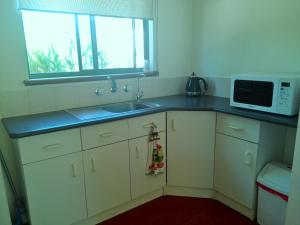 A kitchen or kitchenette at Wenton Farm Holiday Cottages