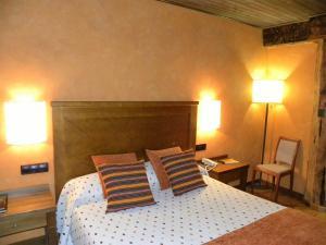 Cama o camas de una habitación en Posada Los Templarios