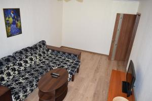 A bed or beds in a room at Apartment on Demyanchuka 1A