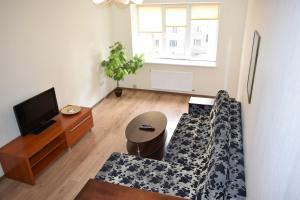 A television and/or entertainment center at Apartment on Demyanchuka 1A