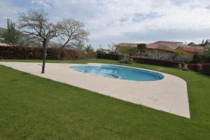 The swimming pool at or near Hotel Aguiar da Pena