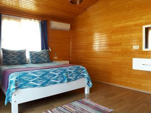 Кровать или кровати в номере Sunset Pension and Apartments