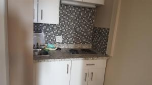 A kitchen or kitchenette at Sunrise Motel
