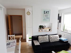 Ein Sitzbereich in der Unterkunft ApartHostel Suessen