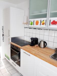 Küche/Küchenzeile in der Unterkunft ApartHostel Suessen