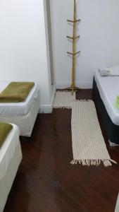 Cama ou camas em um quarto em Pousada Aloha