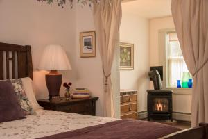 A bed or beds in a room at West Hill House B&B