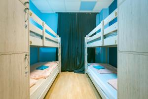 A bunk bed or bunk beds in a room at Hello Hostel