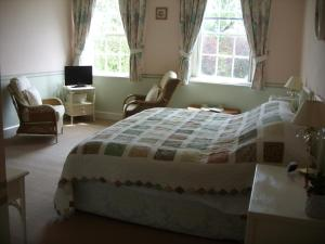 A bed or beds in a room at Howton Grove House
