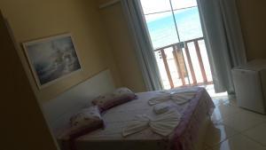 Cama ou camas em um quarto em Pousada Cantinho das Pedras