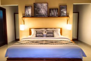 A bed or beds in a room at Utara Villas