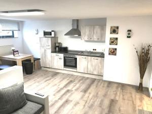 Küche/Küchenzeile in der Unterkunft Ferienwohnung Lo/Go