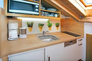 Küche/Küchenzeile in der Unterkunft Gästehaus Christophorus