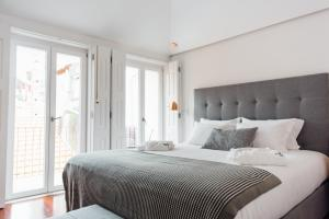 A bed or beds in a room at Myo Design House
