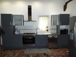 A kitchen or kitchenette at Moulin de Tartay