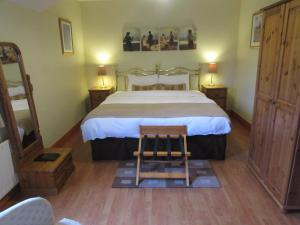 A bed or beds in a room at Dungimmon House