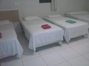 A bed or beds in a room at Hotel Portal do Crato