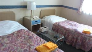 A bed or beds in a room at Business Hotel Motonakano