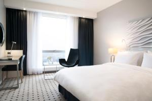 A bed or beds in a room at Radisson Blu Scandinavia Hotel, Copenhagen