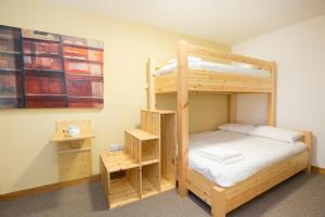 A bunk bed or bunk beds in a room at Black Isle Bar & Rooms