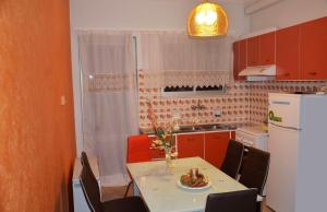 A kitchen or kitchenette at Kalimera Apartment