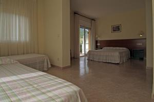 A bed or beds in a room at Fonda Finet