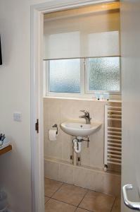 A bathroom at Almond Tree Hotel