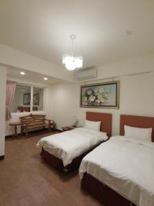 隴之悅驛宿館房間的床