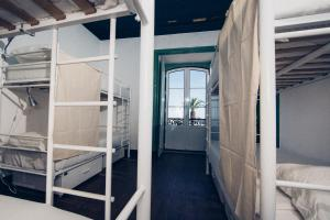 A bunk bed or bunk beds in a room at Boutique Taghostel