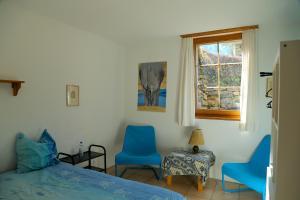Ein Sitzbereich in der Unterkunft Casa Dosc