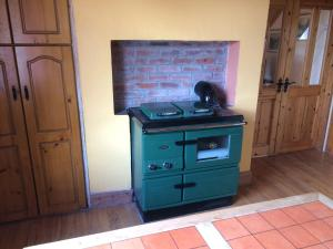 A television and/or entertainment center at Holiday Home 4star Cordal Castleisland