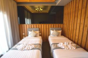 A bed or beds in a room at Sanakeo Boutique & Spa