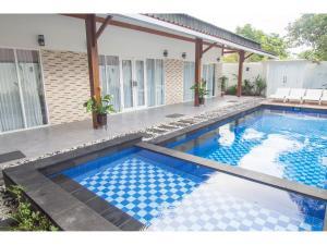 The swimming pool at or near KyGunAya Villa