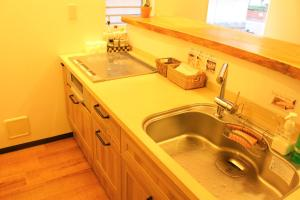 A kitchen or kitchenette at K's House Tokyo - Backpackers Hostel Asakusa