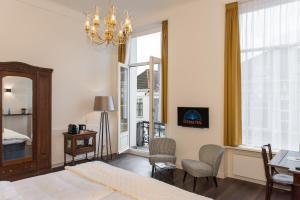 A seating area at Boutique Hotel De Blauwe Pauw
