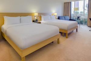 A bed or beds in a room at Hilton Northampton Hotel