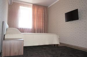 A television and/or entertainment center at Apartment on Kirovskiy prospekt