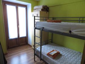 A bunk bed or bunk beds in a room at Matxinbeltzenea
