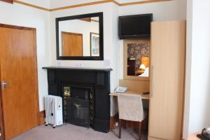 A television and/or entertainment center at Heatherbank Guest House